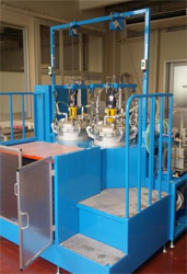 二液自動計量混合吹出装置